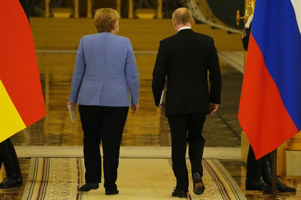 Russian President Vladimir Putin, right, and German Chancellor Angela Merkel leave a joint news conference following their talks in the Kremlin in Moscow, Russia, Friday, Aug. 20, 2021. The talks between Merkel and Putin are expected to focus on Afghanistan, the Ukrainian crisis and the situation in Belarus among other issues. (AP Photo/Alexander Zemlianichenko, Pool)