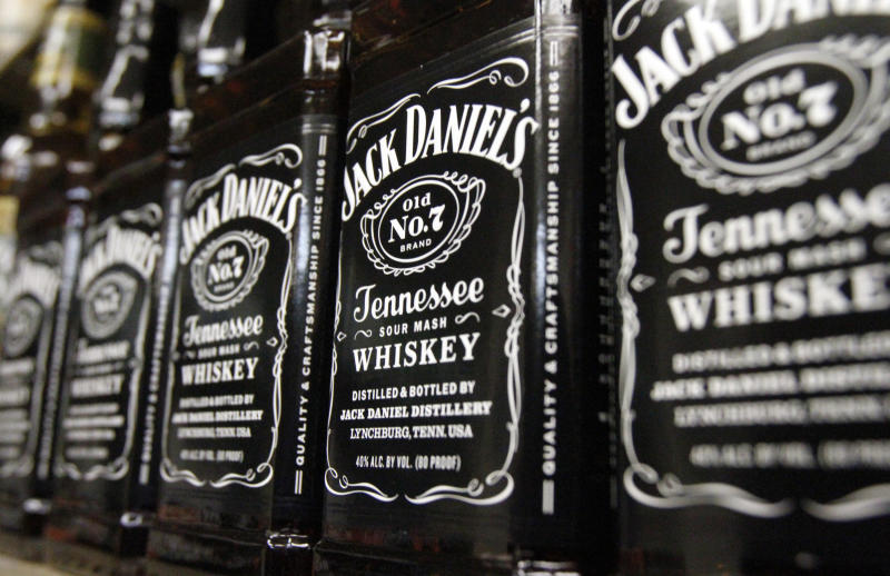 FILE - In this Dec. 5, 2011, file photo, bottles of Jack Daniel's Tennessee Whiskey line the shelves of a liquor outlet in Montpelier, Vt. Spirits maker Brown-Forman Corp. said Wednesday, Aug. 31, 2016, its first-quarter net income fell 7 percent as challenging foreign exchange conditions hampered its performance in emerging overseas markets and the loss of its Southern Comfort brand cut into overall sales. (AP Photo/Toby Talbot, File)