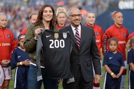 Jan 21, 2018; San Diego, CA, USA; United States soccer vice president Carlos Cordeiro (right) presents former player Hope Solo a commemorative jersey celebrating her 200th appearance for the womens national team before a game against Denmark at SDCCU Stadium. Mandatory Credit: Orlando Ramirez-USA TODAY Sports