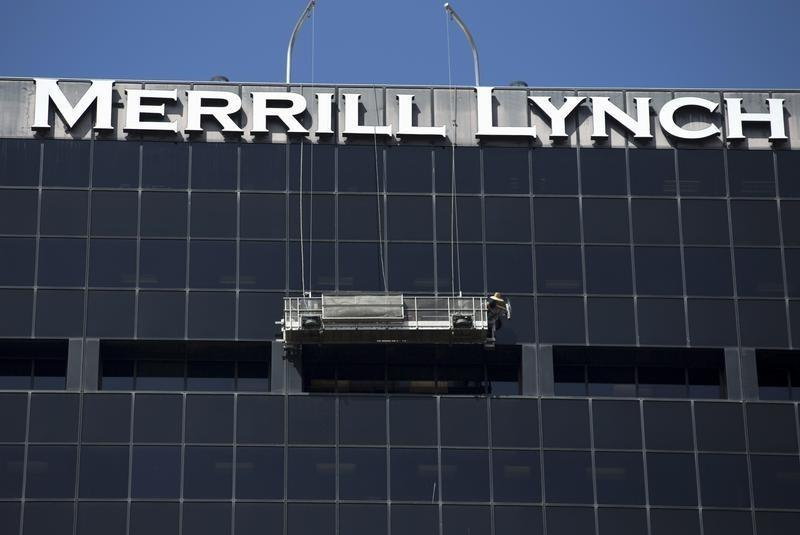A worker washes windows high atop the Merrill Lynch building in downtown San Diego
