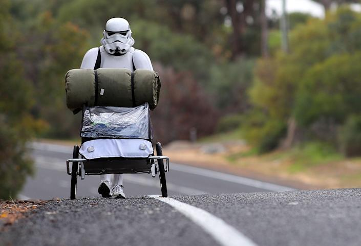 PERTH, AUSTRALIA - JULY 15: Stormtrooper Jacob French is pictured on day 5 of his over 4,000 kilometre journey from Perth to Sydney walking along Old Mandurah road approximately 20 kilometres from Mandurah on July 15, 2011 in Perth, Australia. French aims to walk 35-40 kilometres a day, 5 days a week, in full Stormtrooper costume until he reaches Sydney. French is walking to raise money for the Starlight Foundation - an organisation that aims to brighten the lives of ill and hostpitalised children in Australia. (Photo by Paul Kane/Getty Images)