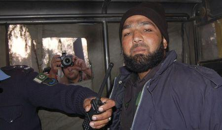 Malik Mumtaz Hussain Qadri, a bodyguard who killed Punjab governor Salman Taseer, is photographed after being detained at the site of Taseer's shooting in Islamabad, in this January 4, 2011 file picture. REUTERS/Saaf-ur-Rahman/Files