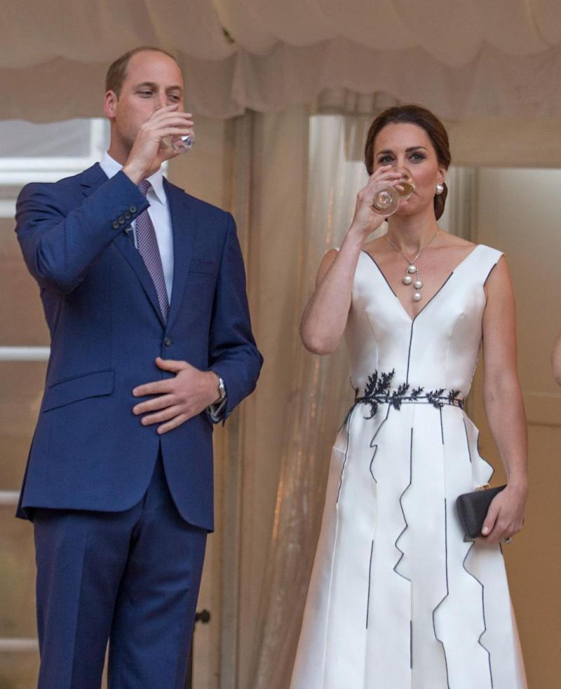 Kate was seen downing champagne in Poland, with reports she conceived a short time later. Photo: Getty