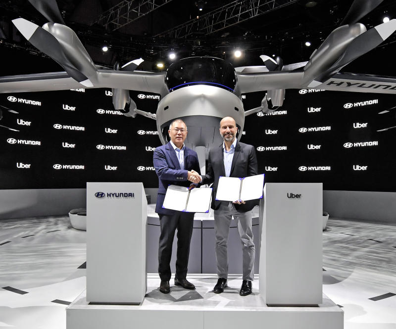 Hyundai Motor Company and Uber have announced a new partnership to develop Uber Air Taxis for a future aerial ride share network and unveiled a new full-scale aircraft concept at CES 2020. From left to right: Euisun Chung, Executive Vice Chairman of Hyundai Motor Group / Dara Khosrowshahi, CEO of Uber