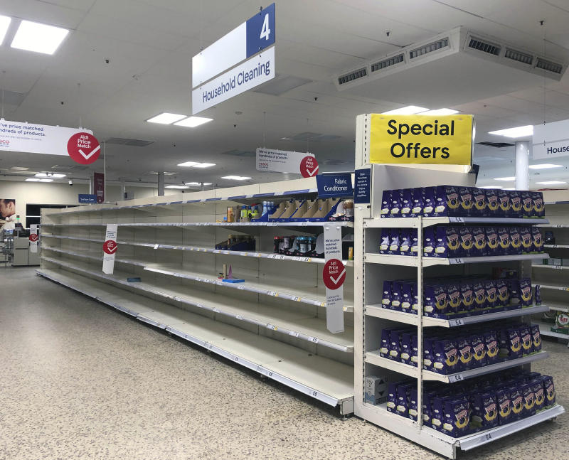 Photo by: KGC-305/STAR MAX/IPx 2020 3/19/20 As COVID-19 coronavirus pandemic continues, supermarkets are becoming more and empty. Staff at Tesco Extra in New Malden explained they simply could not restock the shelves fast enough. The 24hr store has already cut its opening hours to 6am-midnight, to try and cope with the insane amount of shoppers coming through the doors. However at 9pm, despite the car park being very busy, the shelves were pretty much ALL empty, not just the usual long life food aisles and toilet paper aisle. Instead, all fresh fruit, vegetables, meat, beer, crisps, ready meals, dairy etc, was totally empty. Confused customers walked around the store almost in a daze, while others rushed to pick up the few available items left.