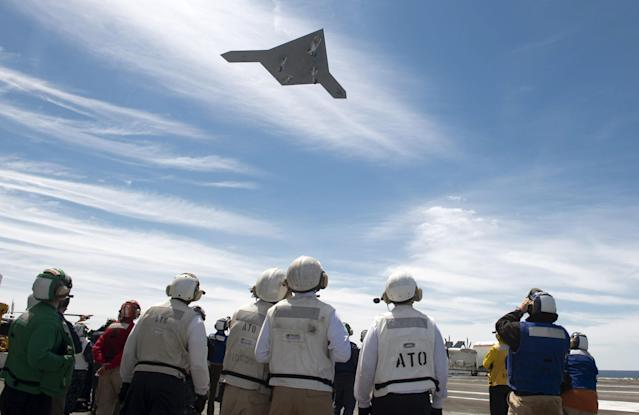 ATLANTIC OCEAN - MAY 14: In this handout released by the U.S. Navy, An X-47B Unmanned Combat Air System (UCAS) demonstrator flies over the flight deck of the aircraft carrier USS George H.W. Bush (CVN 77) May 14, 2013 in the Atlantic Ocean. George H.W. Bush is the first aircraft carrier to sucessfully catapult-launch an unmanned aircraft from its flight deck. The Navy plans to have unmanned aircraft on each of its carriers to be used for surveillance and be armed and used in combat roles. (Photo by Mass Communication Specialist 2nd Class Timothy Walter/U.S. Navy via Getty Images)