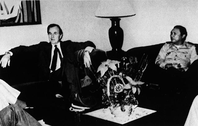 "<p>Vice President George H.W. Bush and Panamanian leader Manuel Antonio Noriega at Panama City Airport, Dec. 10, 1983, in a photo from Britain's Thames Television. (AP Photo/Thames TV ""This Week"") </p>"