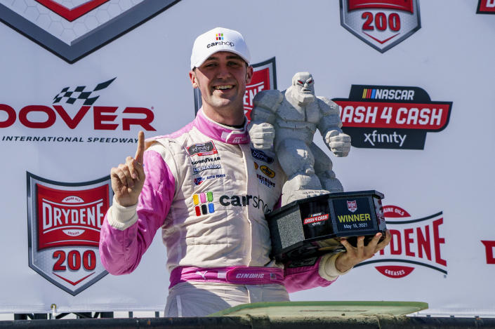 Austin Cindric holds the trophy following his victory in a NASCAR Xfinity Series auto race at Dover International Speedway, Saturday, May 15, 2021, in Dover, Del. (AP Photo/Chris Szagola)