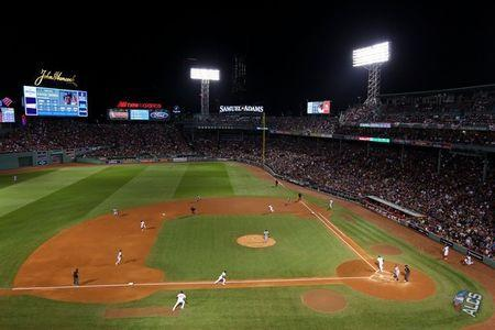 FILE PHOTO: Oct 14, 2018; Boston, MA, USA; Boston Red Sox third baseman Rafael Devers (11) hits an RBI single driving in left fielder Andrew Benintendi (16) during first inning against the Houston Astros during game two of the 2018 ALCS playoff baseball series at Fenway Park. Mandatory Credit: Paul Rutherford-USA TODAY Sports