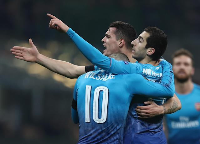 Arsenal players celebrate Mkhitaryan's opener in a statement moment for Arsene Wenger's side.