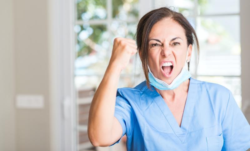 doctor woman annoyed and frustrated shouting with anger