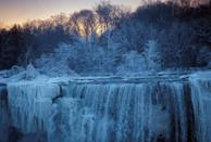 <p>Ice and water flow over the American Falls, viewed from the Canadian side in Niagara Falls, Ontario, Canada, January 3, 2018. REUTERS/Aaron Lynett </p>