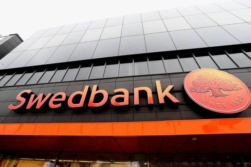 Swedbank sign is seen on the local headquarters building in Tallinn