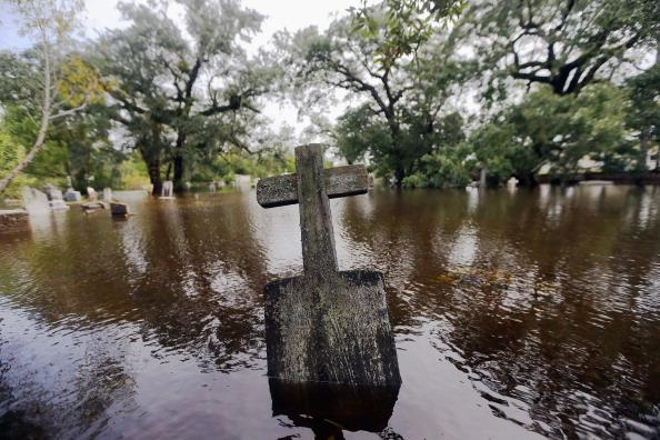 A headstone sits in a flooded cemetery on August 31, 2012 in Slidell, Louisiana. Louisiana residents are coping with the aftermath of Hurricane Isaac with ongoing flooding, destroyed property and many still without electricity. (Photo by Mario Tama/Getty Images)