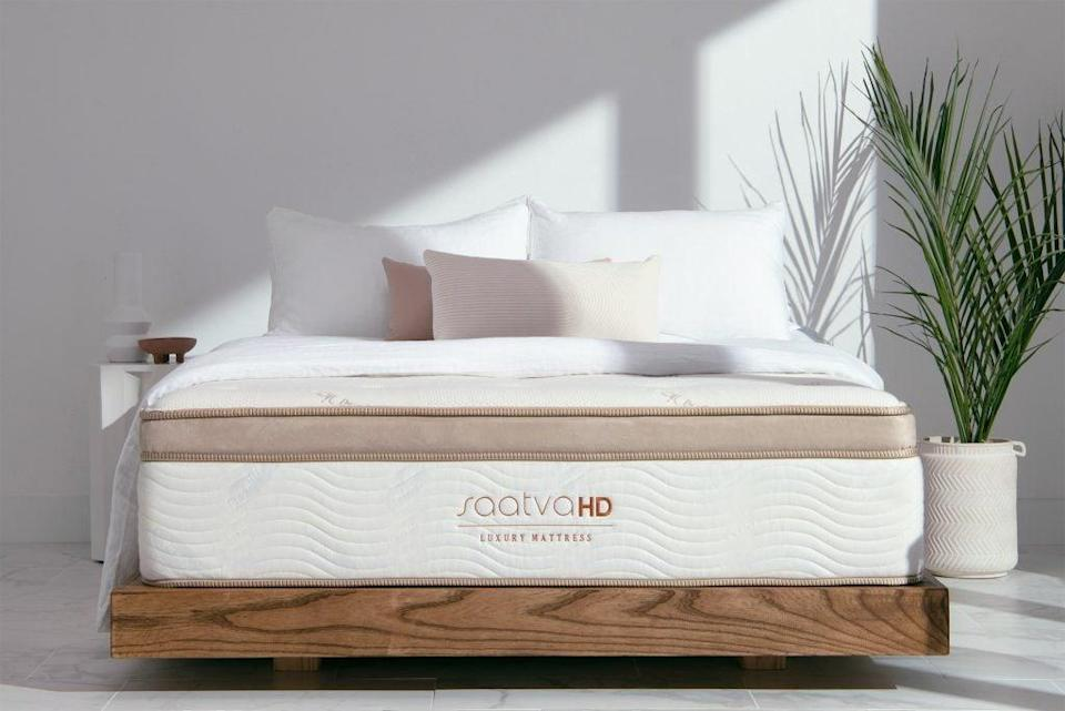 """<h3><a href=""""https://www.saatva.com/mattresses/saatva-classic"""" rel=""""nofollow noopener"""" target=""""_blank"""" data-ylk=""""slk:Saatva Classic Luxury Firm Mattress"""" class=""""link rapid-noclick-resp"""">Saatva Classic Luxury Firm Mattress</a></h3><br><strong>Mattress Type: </strong>Hybrid (Foam & Spring) <br><strong>Sleeper Style: </strong>Side, Stomach, & Back<br><strong>Pros: </strong>Soft-Yet-Firm Support<br><strong>Cons: </strong>Mattress Pattern<br><br>""""My ideal mattress is somewhat of an impossibility: My back craves something super-firm, but I need my mattress to allow me to sleep on my side and stomach without my extremities losing circulation. I despise the feeling of being trapped in a foam mattress like a bug in honey, but I also don't want to wake up each time a partner moves on the other side of the bed. What I really want is a mattress that can read my mind and body — here's hoping my grandchild's grandchild will one day invent it to honor my legacy. But, as such, I've become resigned to the fact that I was born to doze in the wrong century. I'm like Oscar Wilde, but for sleeping.""""<br> <br>""""But, Saatva's <a href=""""https://www.saatva.com/mattresses/saatva-classic"""" rel=""""nofollow noopener"""" target=""""_blank"""" data-ylk=""""slk:Classic in Luxury Firm"""" class=""""link rapid-noclick-resp"""">Classic in Luxury Firm</a> comes as close to the future as I've seen. Unlike many online mattresses, it has springs inside, which is a must for me, as all-foam mattresses give me that 'help I'm stuck and I can't get up' feeling. Also, it doesn't come in a box, which means no weird smells. The company let me review the thinner mattress for free, in order to fit my sheets, and I was pleased that it still felt substantial. Upon the first trial, I was immediately skeptical of its 'Euro pillow top' as too squishy and hilly, as I like a more uniform surface, but the thought fled my mind as quickly as it entered it because I fell asleep immediately. I woke up without the sore back I typically get from beds tha"""