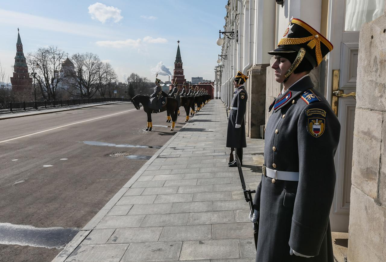 Honor guards stand at the Grand Kremlin Palace for a meeting of Russian President Vladimir Putin and Chinese President Xi Jinping in the Kremlin in Moscow, Friday, March 22, 2013. Russia is Xi Jinping's first foreign destination as China's president. Xi's talks with Putin on Friday are set to focus on oil and gas as China seeks to secure new energy resources to fuel its growing economy. (AP Photo/Sergei Ilnitsky, Pool)