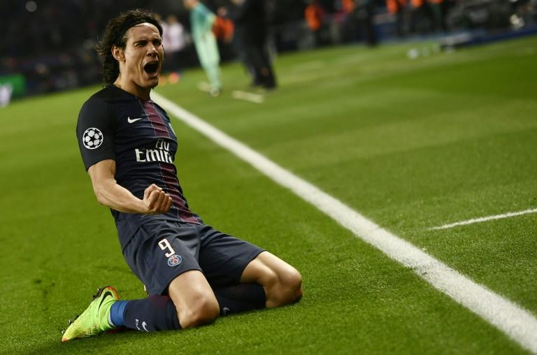 Paris Saint-Germain's Edinson Cavani celebrates after scoring a goal during their UEFA Champions League round of 16 first leg match against Barcelona, at the Parc des Princes stadium in Paris, on February 14, 2017