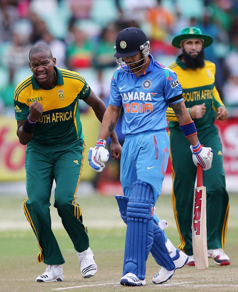 DURBAN, SOUTH AFRICA - DECEMBER 08: Lonwabo Tsotsobe celebrates Virat Kohli's wicket  during the 2nd Momentum ODI match between South Africa and India at Sahara Stadium Kingsmead on December 08, 2013 in Durban, South Africa. (Photo by Anesh Debiky/Gallo Images/Getty Images)