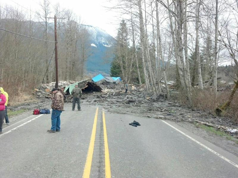This photo provided by the Washington State Patrol shows the aftermath of a mudslide that moved a house with people inside in Snohomish County on Saturday March 22, 2014. The Washington Department of Transportation says mud, trees and building materials are blocking both directions of State Route 530 near the town of Oso. Search and rescue operations are underway by Snohomish County crews and the Washington State Patrol. Spokesman Bart Treece of the Washington State Department of Transportation says he doesn't know how long the two-lane rural road will be closed. He says drivers are advised to find another way to get between Darrington and Arlington. (AP Photo/Washington State Patrol)