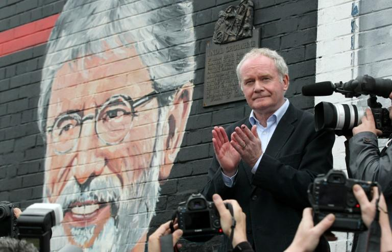 Northern Ireland's late deputy first minister Martin McGuinness speaks at a rally in support of Sinn Fein leader Gerry Adams in Belfast in May 2014