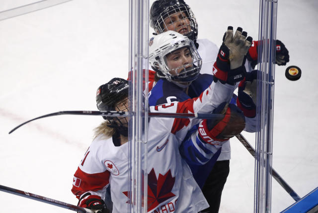 <p>Haley Irwin (21), of Canada, Megan Keller (5), of the United States, and Rebecca Johnston (6), of Canada, reach for the puck during the second period of the women's gold medal hockey game at the 2018 Winter Olympics in Gangneung, South Korea, Thursday, Feb. 22, 2018. (AP Photo/Jae C. Hong) </p>