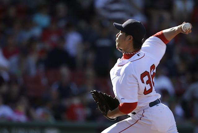 Boston Red Sox relief pitcher Junichi Tazawa delivers against the Cleveland Indians in the eleventh inning of a baseball game on Sunday, June 15, 2014, in Boston. The Indians won 3-2. (AP Photo/Steven Senne)