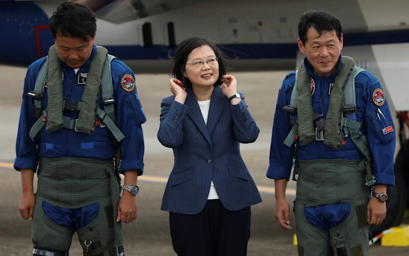 Taiwanese President Tsai Ing-Wen (C) has called for calm as diplomatic tension rises in the East China Sea - Ann Wang/Reuters