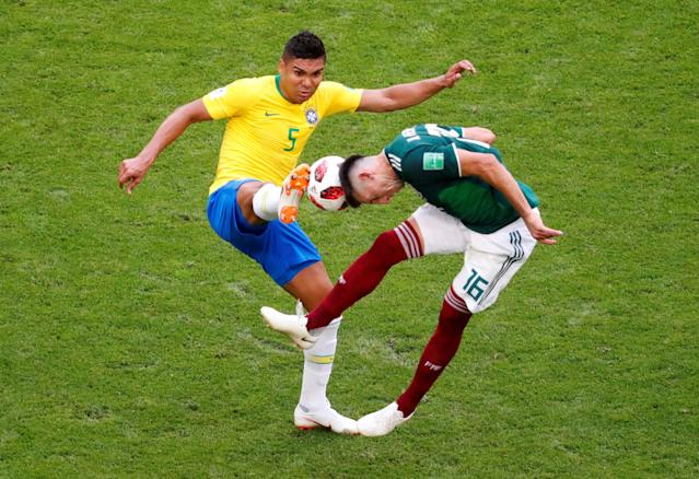 <p>Brazil's Casemiro in action with Mexico's Hector Herrera REUTERS/David Gray </p>