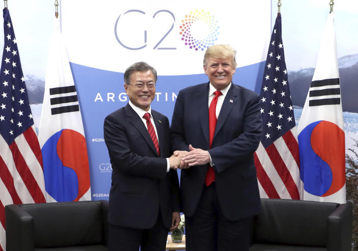 "In this Nov. 30, 2018, photo, South Korean President Moon Jae-in, left, shakes hands with U.S. President Donald Trump during a meeting on the sidelines of the Group of 20 Leaders' Summit in Buenos Aires, Argentina. Moon says U.S. President Donald Trump told him he has a ""very friendly view"" of North Korean leader Kim Jong Un and wants to grant his wishes if he denuclearizes. (Hwang Kwang-mo/Yonhap via AP)"