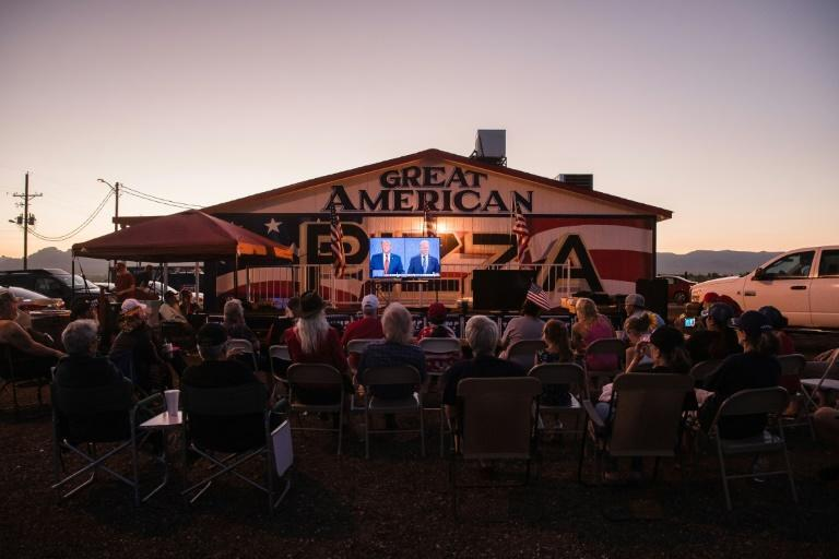 Donald Trump supporters watching the last presidential debate in Golden Valley, Arizona -- the event saw Trump pivot to a far more cheerful, even-keeled demeanour