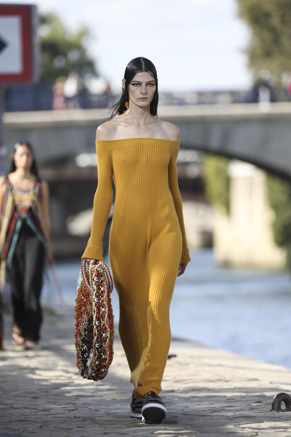 A model wears a creation for the Chloe Spring-Summer 2022 ready-to-wear fashion show presented in Paris, Thursday, Sept. 30, 2021. (Photo by Vianney Le Caer/Invision/AP)