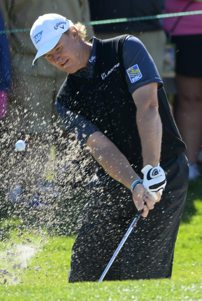 Ernie Els, of South Africa, hits out of bunker onto the first green during the first round of the Arnold Palmer Invitational golf tournament in Orlando, Fla., Thursday, March 21, 2013.(AP Photo/Phelan M. Ebenhack)