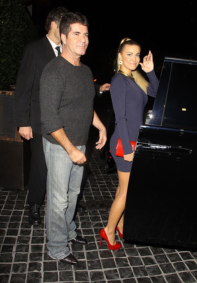 **EXCLUSIVE** NEW COUPLE? Simon Cowell and Carmen Electra look to have reconnected as they are spotted leaving Cecconi's restaurant together