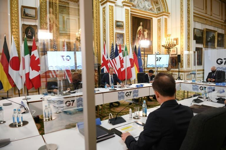 'We want to see China stepping up to the plate and playing its full role,' said Raab (centre) Britain's Foreign Secretary Dominic Raab (C) is flanked by his Canadian and Japanese counterparts at a G7 meeting focused on China