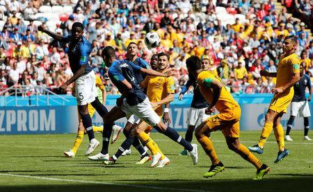 France's Samuel Umtiti handles the ball and concedes a penalty. REUTERS/Toru Hanai