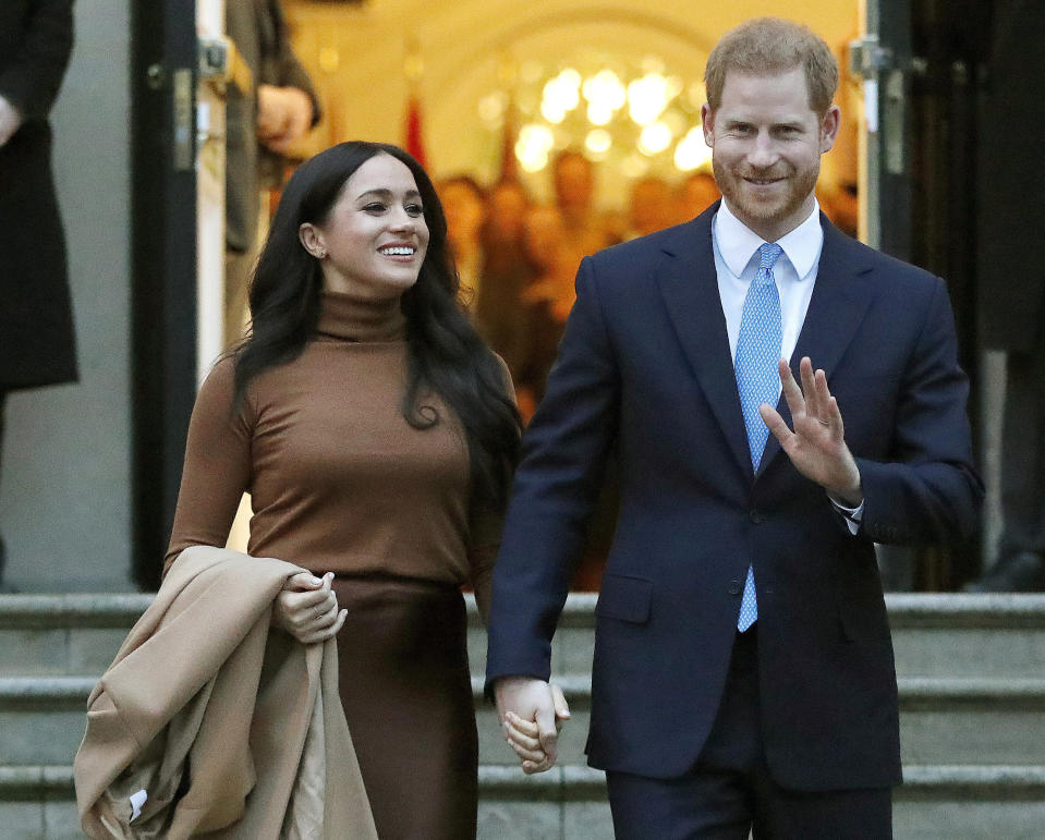 FILE - Prince Harry and Meghan, the Duke and Duchess of Sussex, leave after visiting Canada House on Jan. 7, 2020, in London. The second baby for the Duke and Duchess of Sussex is officially here: Meghan gave birth to a healthy girl on Friday, June 4, 2021. (AP Photo/Frank Augstein, File)