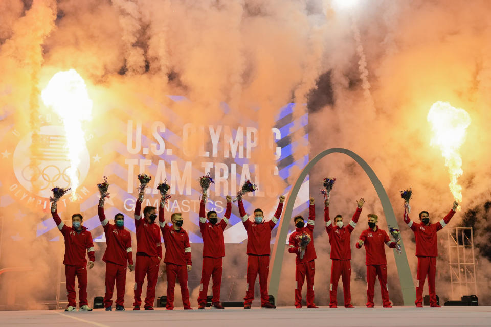 Members of the US Men's Olympic Gymnastic Team and alternates stand on stage after the conclusion of the men's U.S. Olympic Gymnastics Trials Saturday, June 26, 2021, in St. Louis. (AP Photo/Jeff Roberson)