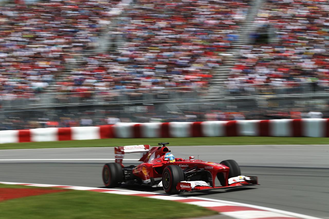 MONTREAL, QC - JUNE 09:  Fernando Alonso of Spain and Ferrari drives during the Canadian Formula One Grand Prix at the Circuit Gilles Villeneuve on June 9, 2013 in Montreal, Canada.  (Photo by Mark Thompson/Getty Images)