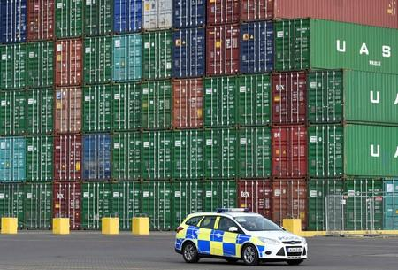 FILE PHOTO: British port police patrol as the largest container ship in world, CSCL Globe, docks during maiden voyage, at the port of Felixstowe in south east England.