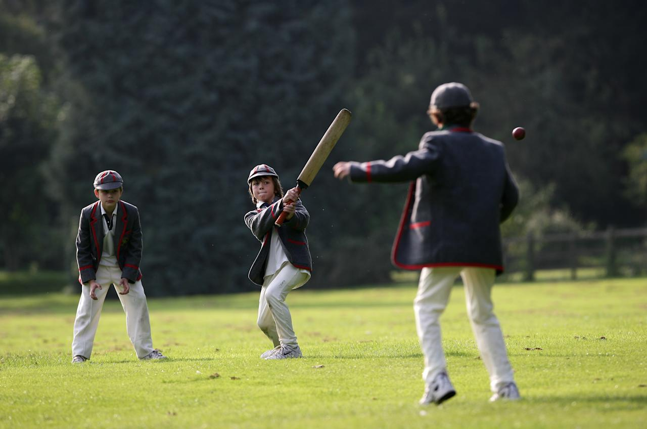 THURGATON, ENGLAND - AUGUST 20: School boys play on the boundary's edge after a game of cricket on August 20, 2008 in the village of Thurgaton, England.  (Photo by Laurence Griffiths/Getty Images)