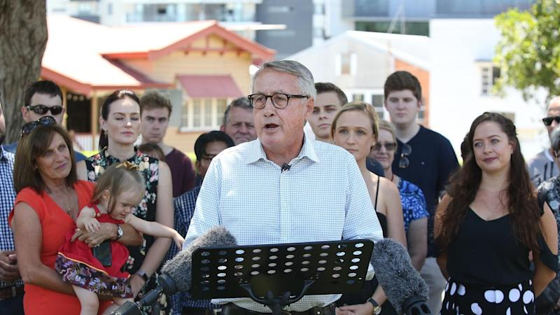 Wayne Swan, surrounded by family, has announced he will retire at the next federal election