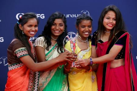 Neeta Kumari, Hema Kumari, Konika Kumari, and Radha Kumari pose after Yuwa-India wins the Sport for Good award