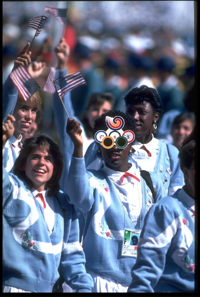 16 SEP 1988: THE TEAM FROM THE UNITED STATES ARE PHOTOGRAPHED WAVING THE FLAG AND ENJOYING THEMSELVES AT THE OPENING CEREMONY OF THE 1988 SUMMER OLYMPICS HELD IN SEOUL.