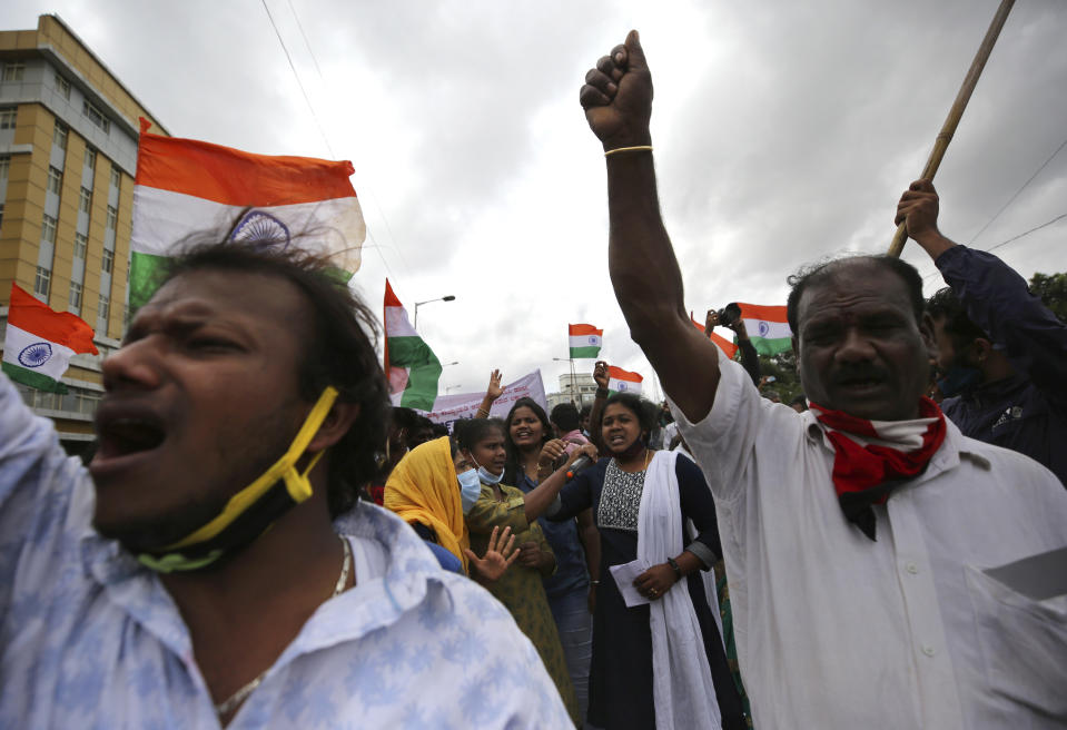 Indian farmers and activists shout anti-government slogans during a protest against farm bills in Bengaluru, India, Monday, Sept. 21, 2020. (AP Photo/Aijaz Rahi)