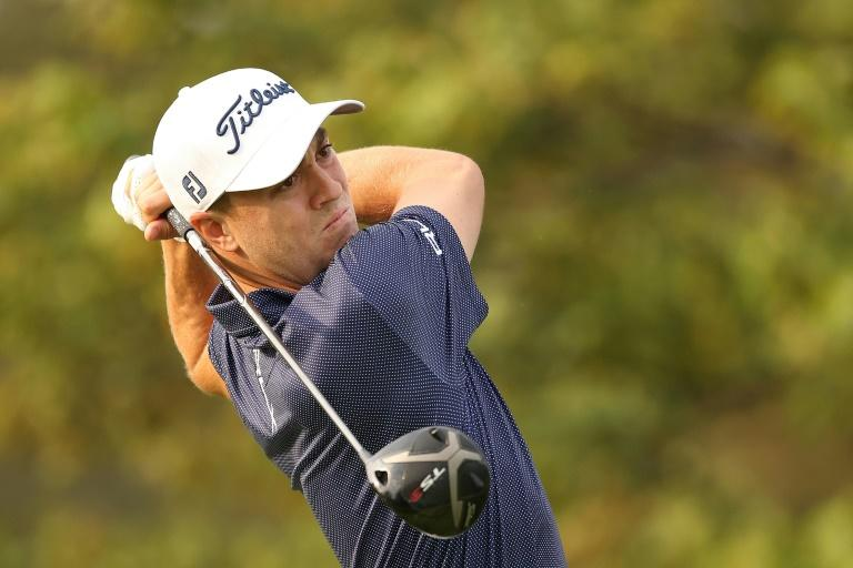 Thomas grabs US Open lead while ace-hitter Reed, McIlroy lurk