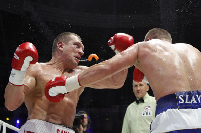 Ukraine's Vyacheslav Glazkov (R) punches Germany's Konstantin Airich during their WBC Baltic Silver heavyweight title fight in Moscow September 8, 2012. Glazkov won the match. Picture taken September 8, 2012. REUTERS/Maxim Shemetov (RUSSIA - Tags: SPORT BOXING PROFILE TPX IMAGES OF THE DAY)