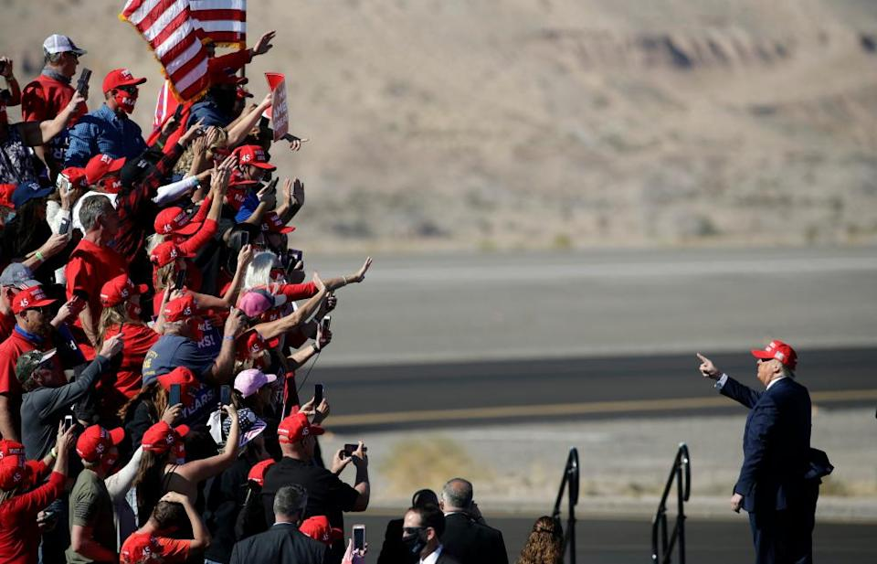 Donald Trump gestures to supporters after a rally in Bullhead City, Arizona, on 28 October.