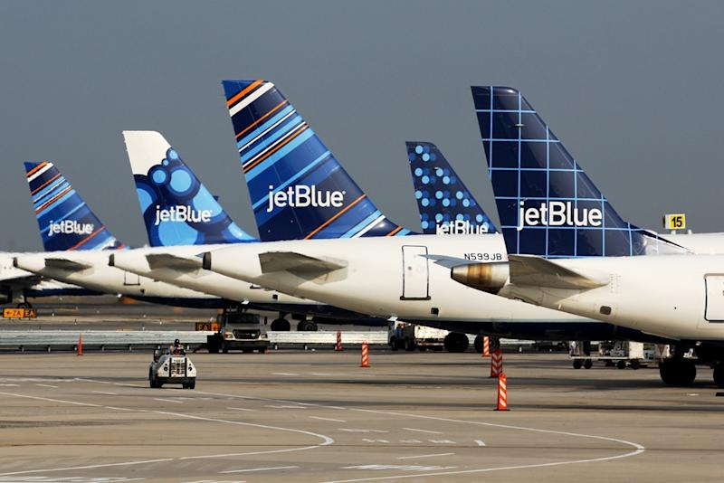 A line of JetBlue tail fins.