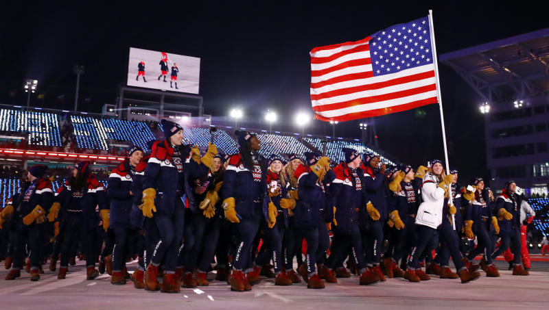 Team USA enters the stadium during opening ceremonies on Friday. (Kai Pfaffenbach / Reuters)