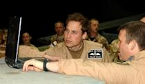 <p>Prince William (Flying Officer Wales) visiting Kandahar Airfield, Afghanistan, in April 2008. He flew for the RAF and the Navy before taking a job after he was married with the air ambulance. (MOD)</p>